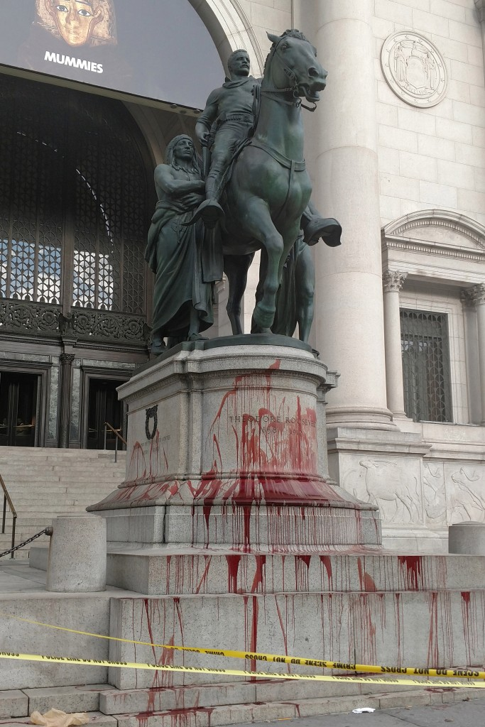 This image has an empty alt attribute; its file name is teddy-roosevelt-statue-defaced.jpg